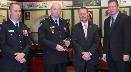 L to R: Senior Firefighter Darren Vatcher, Superintendent Gerry Byrne, the Director-General of Emergency Management Australia Tony Pearce and Emergency Services Minister Nathan Rees