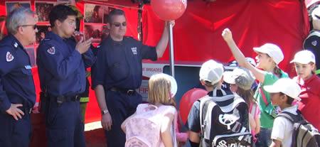 Station Officer Steve Gleeson, Senior Firefighter Adam Parer and Senior Fire Fighter Brett Hickey educating the local children at the Mattara Festival, Photo by Firefighter Desmond Hanrahan