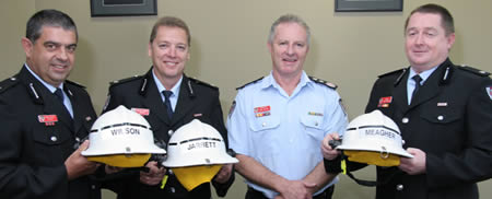 Newly-appointed Inspectors Wilson, Jarrett and Meagher receive their helmets from Commissioner Mullins