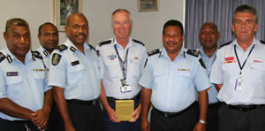 Superintendent Tom Milburn (4th from L) hands over to Inspector Graham Webb (2nd from R)